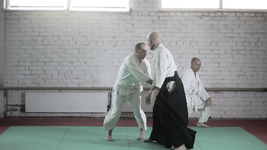 athletes in a kimono demonstrating martial arts techniques. martial arts