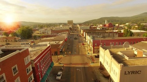 Aerial of small town America at sunrise on main street