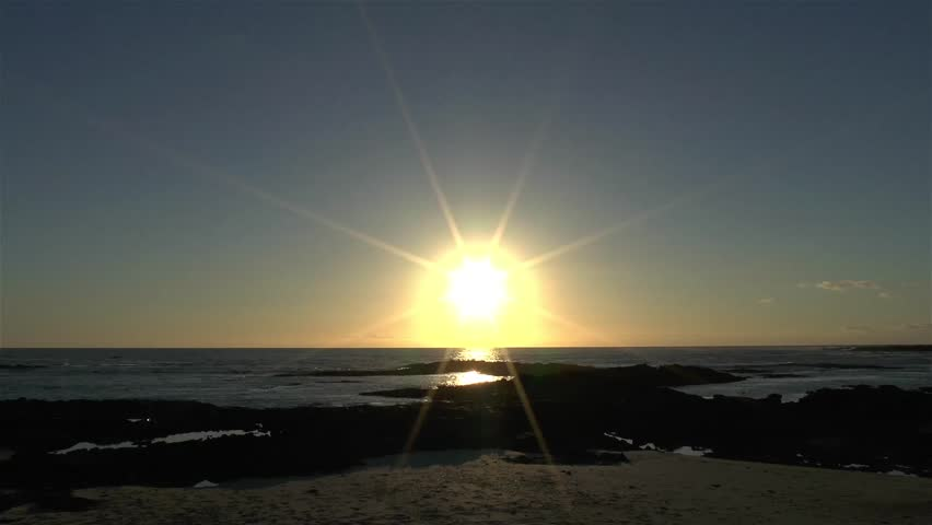 Time laps sunset at a tropical sandy beach with a deep orange sun sinking in the Atlantic Ocean at clear blue sky. | Shutterstock HD Video #17465857