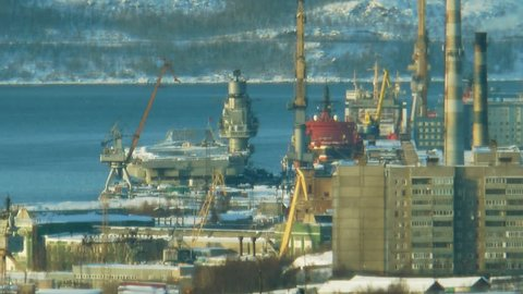 "Russia, Murmansk, overlooking the city and Kola Bay, away nuclear-powered icebreaker ""Yamal"" and the cruiser ""Admiral Kuznetsov""."