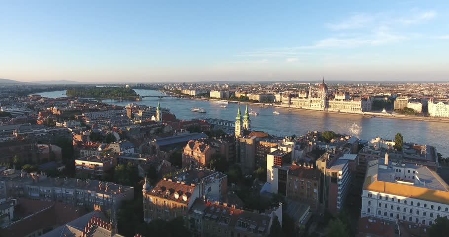 Aerial footage taken from a drone shows the Hungarian Parliament and the river Danube in Budapest sunset.