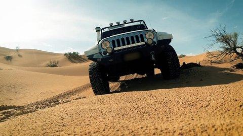 driving off-road car in the sahara desert