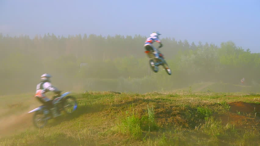 Extreme sports motocross motorcycle jumping on a race on high speed rail amped through mud super slow motion racers fly over jump freestyle stunt | Shutterstock HD Video #17504581