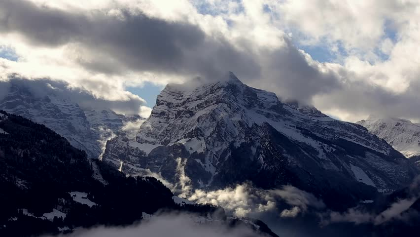 4k time lapse of clouds mass rolling over Tibet snow-Covered mountains,Danggula,