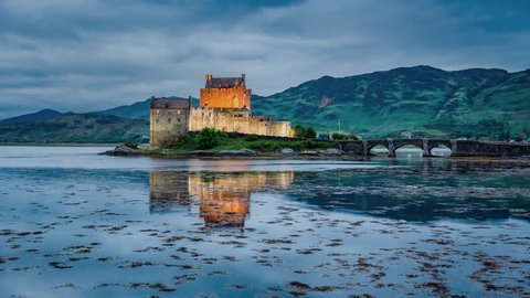 Beautiful sunset over the lake at Eilean Donan Castle in Scotland, 4k, timelapse