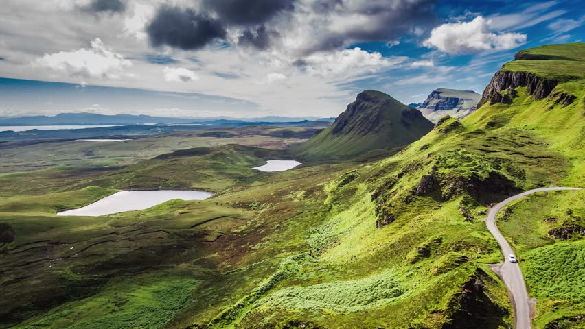 Dynamic sky over valley in mountain Quiraing, Scotland, United Kingdom, 4k, timelapse