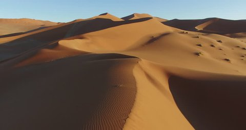 4K aerial view of endless sand dunes of the Namib desert