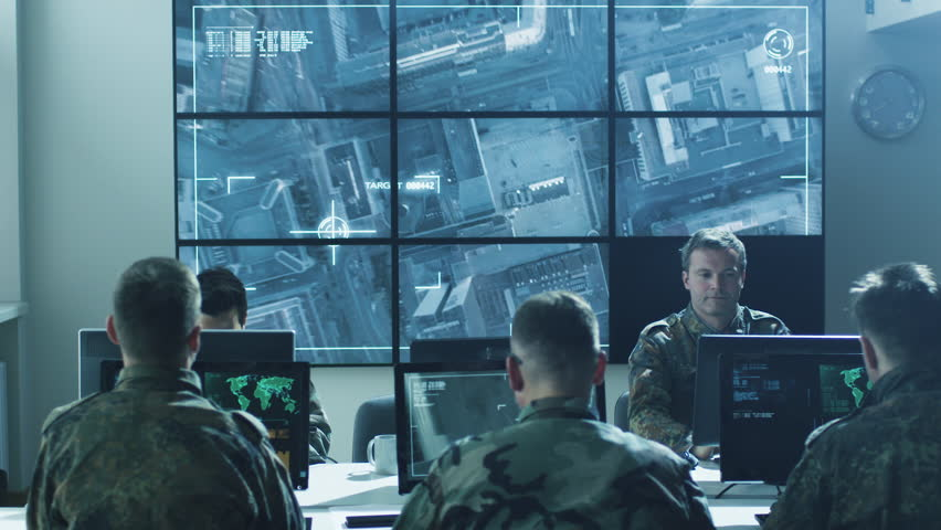 Group of Military IT Professionals in Monitoring Room on Military Base. Shot on RED Cinema Camera in 4K (UHD).