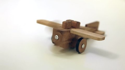 Airplane wood toy with spinning airscrew.