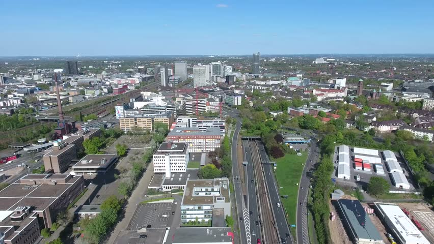 Essen City Ruhr from Highway A40 passing TV Tower flying to an Area of many Railway Tracks