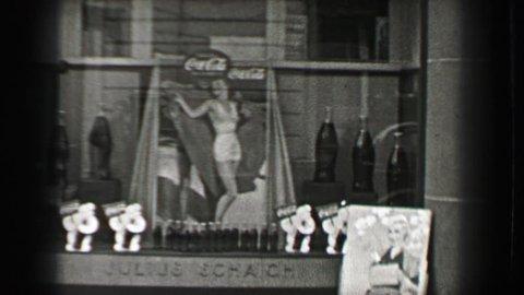 BERLIN, GERMANY 1937: Coca Cola advertising in German storefront aryan race women idolatry.
