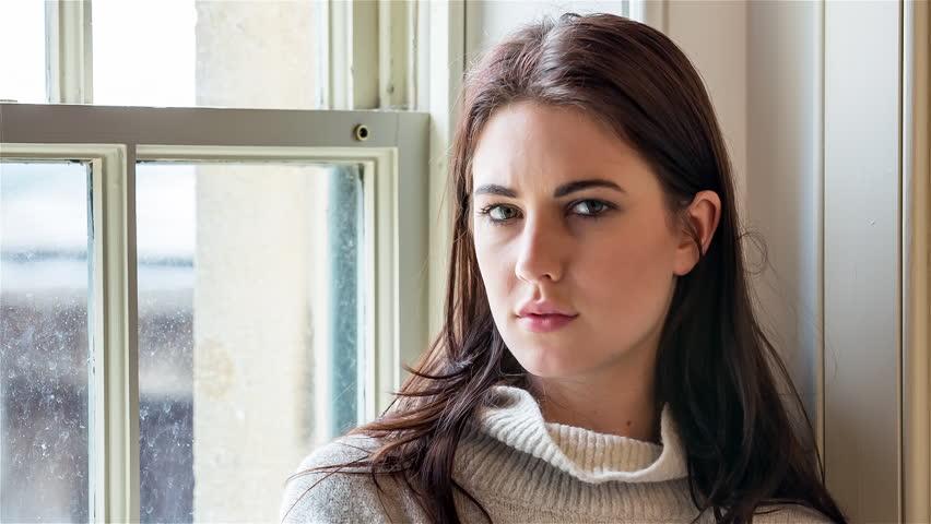Beautiful Female Standing by Window