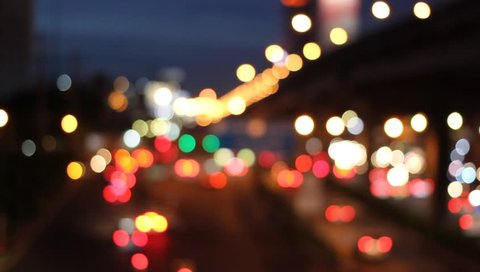 Abstract circular bokeh motion lens blur backround of city and street light on rainy day at night time in Thaialnd