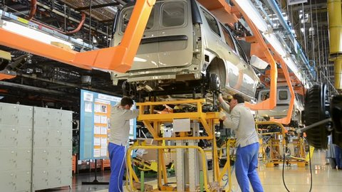 TOGLIATTI - SEP 30: People work at assembly of cars Lada Kalina on conveyor of factory AutoVAZ, on September 30, 2011 in Togliatti, Russia.