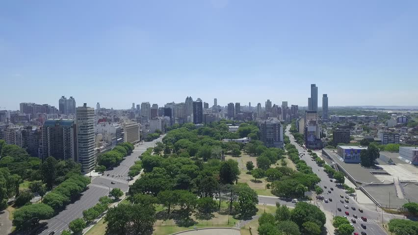 Aerial Drone Scene of Buenos Aires City. Traveling in. City Traffic, Trees, Buildings and Park. City Landscape. Figueroa Alcorta Avenue - Buenos Aires - Argentine