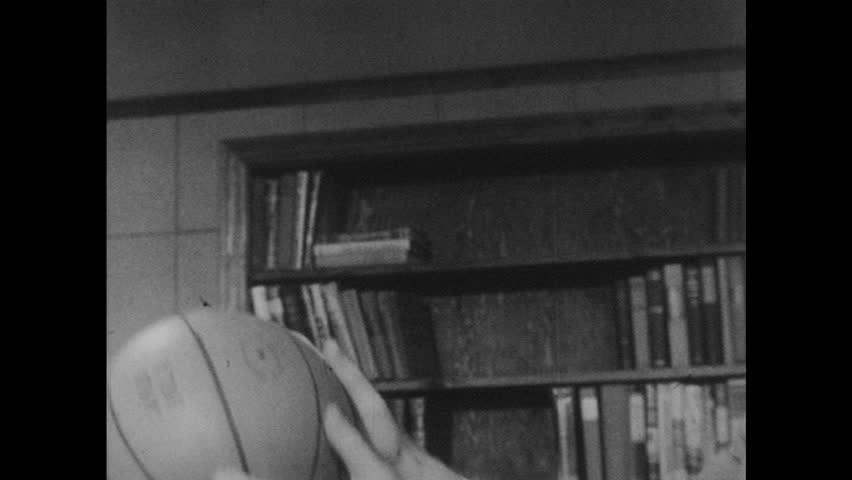 UNITED STATES 1950s: Close up, hand throws basketball / Men toss basketball, man talks into camera / Dissolve, man on basketball court. | Shutterstock HD Video #17728207