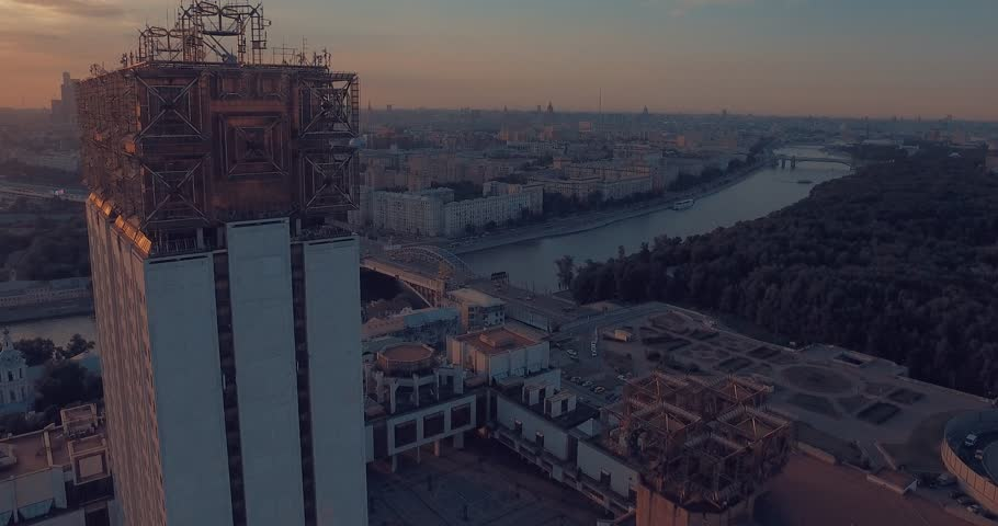 Aerial view of the Luzhnetsky metro bridge, passenger boat floating along the Moscow River, heavy traffic and building of Russian Academy of Sciences during amazing sunset  in Moscow, Russia.        Shutterstock HD Video #17747380
