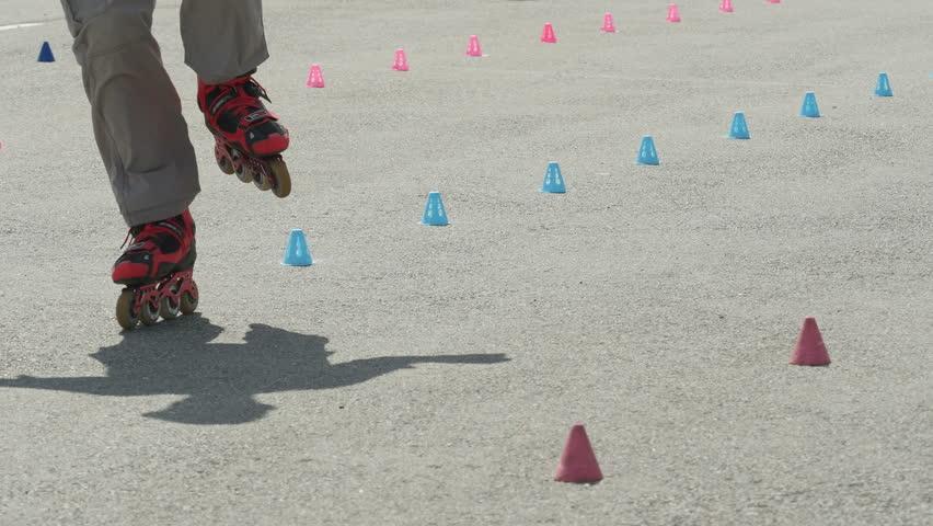 Freestyle skates. Roller skate slalom between cones.