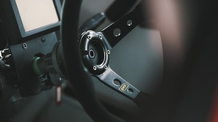 MOSCOW, RUSSIA - MAY 15, 2016 : Drift Car Interior. Rack focus, close up on wheel and gearshift clutch  | Shutterstock HD Video #17793646