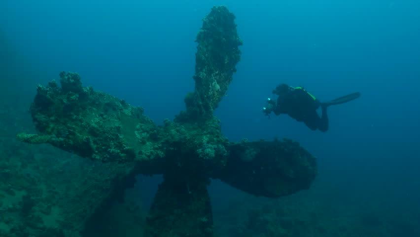 Big propeller and scuba diver in Umbria shipwreck - May 2015: Red Sea, Sudan | Shutterstock HD Video #17809501