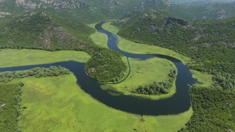 Watercourse bend of river Rjieka Crnojevica. Beauty nature in mountains. Part of Skadar lake and national park. Montenegro