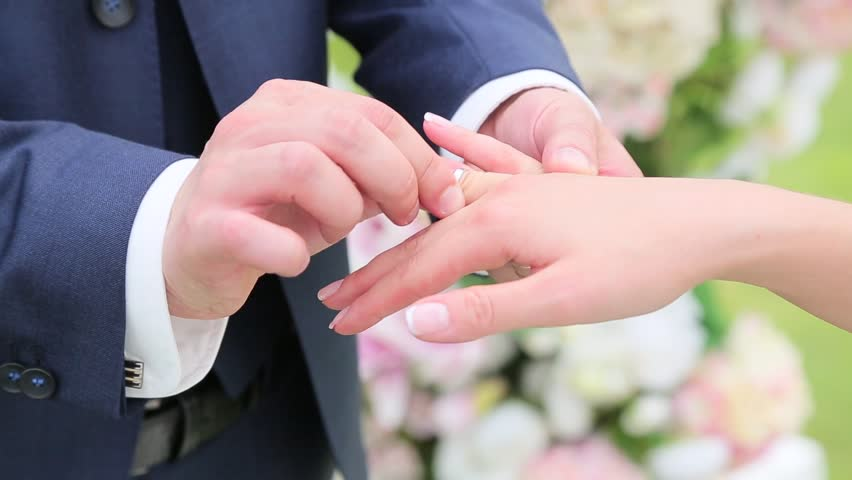 Groom Wears Ring On The Brideu0027s Finger.   HD Stock Footage Clip