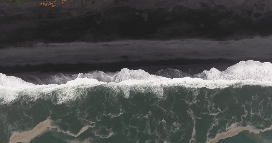 Stationary Overhead Shot Of Seashore At Black Sand Beach in V\xCC_k \xCC_ M\xCC_rdal Iceland