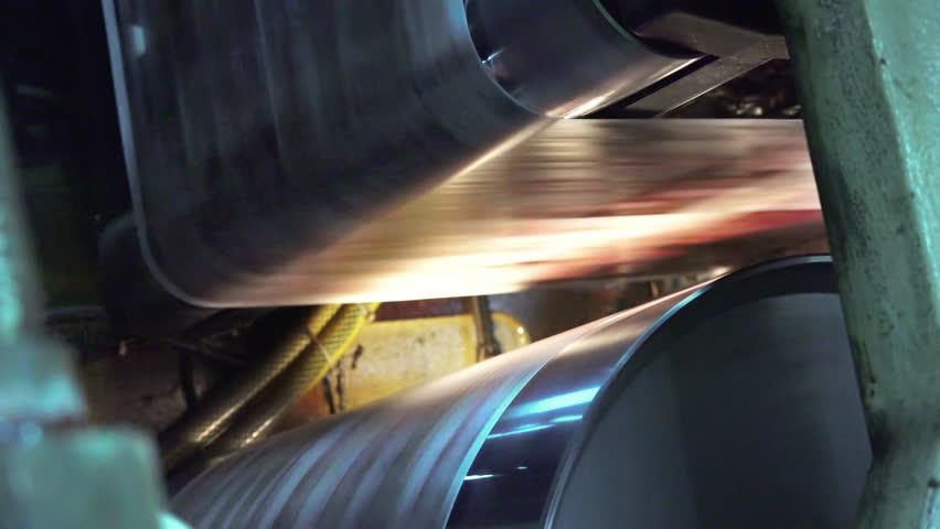 Web set offset print shop newspapers Printing (Loop), Newspapers coming off the rotation printing press industrial machine, , loop background