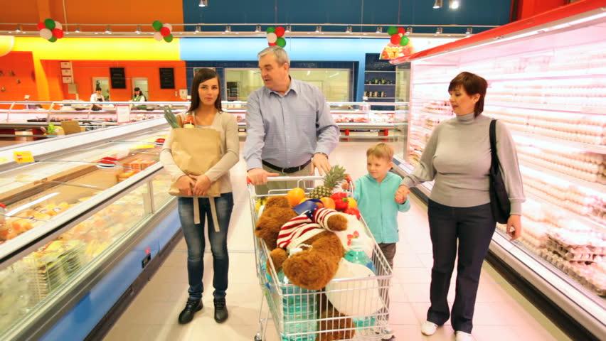 Happy family walking along the shelves in supermarket | Shutterstock HD Video #1793621