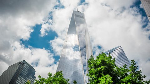 New York City, USA - July 5, 2016: Timelapse view of the Freedom Tower, or One World Trade Center, the tallest building in the Western Hemisphere, located in Manhattan, New York City, United States.