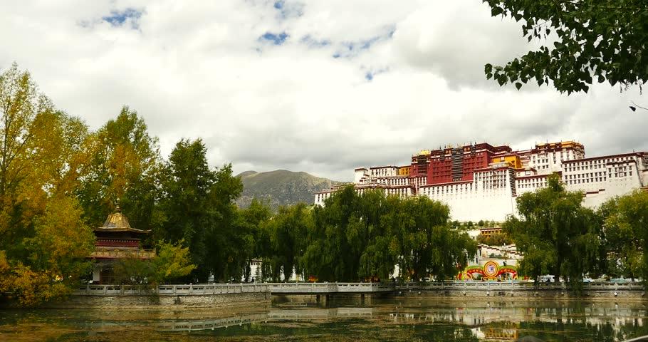 4k Potala reflection on lake in Lhasa park,Tibet.lake with willow. gh2_09763_4k