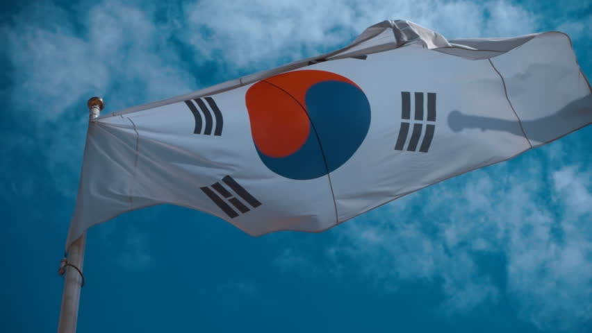 South Korean flag on the flagpole waving in the wind against a blue sky with clouds. Slow motion, high speed camera, 250fps #17968810