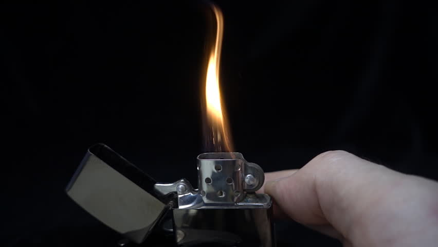 Ignite a zippo by finger on black background. S-log - High Dynamic Range. Slow motion, high speed camera, 250fps