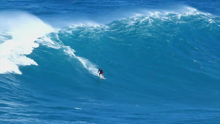"""MAUI, HI - MARCH 13: Professional surfer Yuri Soledade rides a giant wave at the legendary big wave surf break known as """"Jaws"""" during one the largest swells of the winter March 13, 2011 in Maui, HI."""
