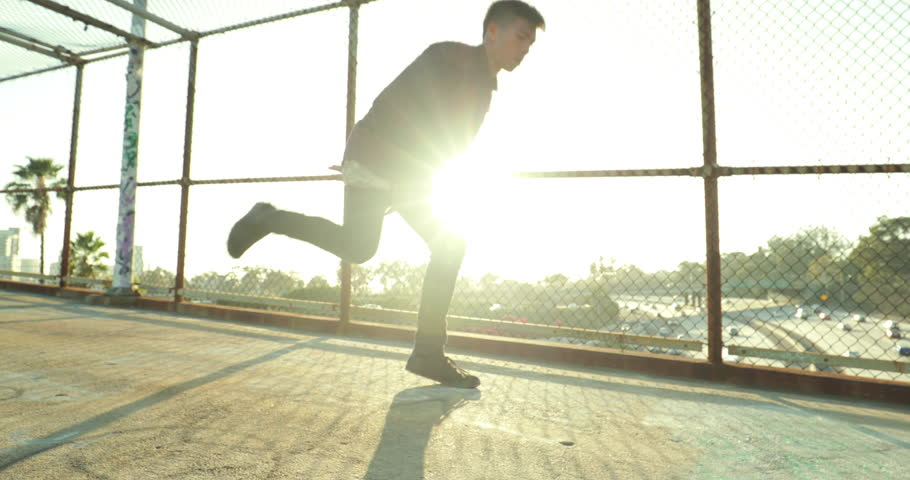Low Angle Young Man Breakdancing At Sunset In Slow Motion #18004501