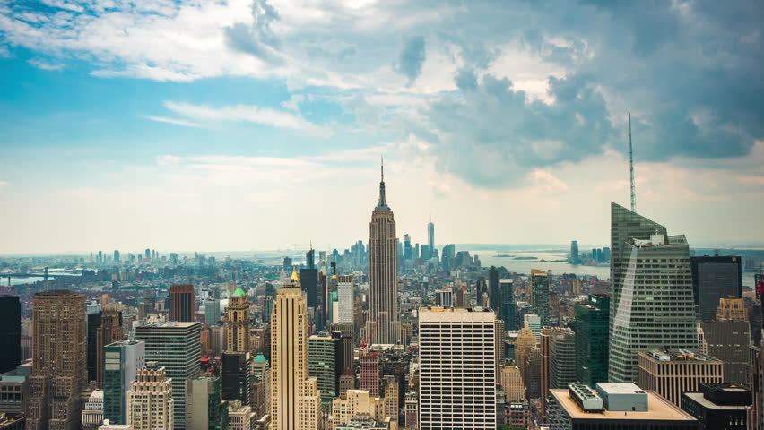 Time lapse view of New York City skyline including the Empire State Building and Freedom Tower in Manhattan, New York, United States.