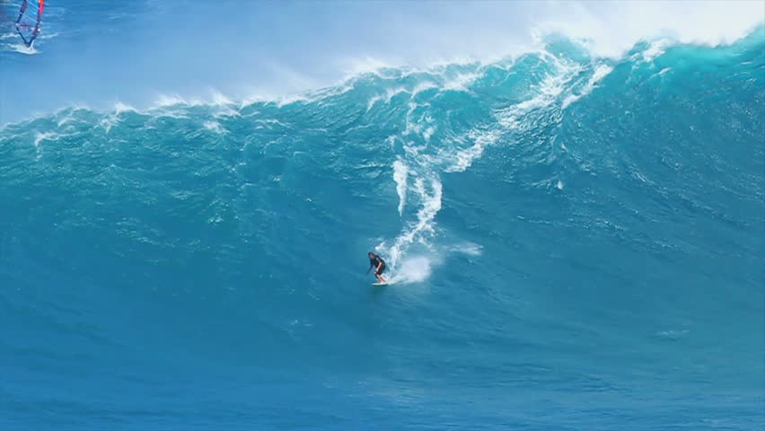 "MAUI, HI - MARCH 13: Professional surfer Laird Hamilton rides a giant wave at the legendary big wave surf break known as ""Jaws"" during one the largest swells of the winter March 13, 2011 in Maui, HI."
