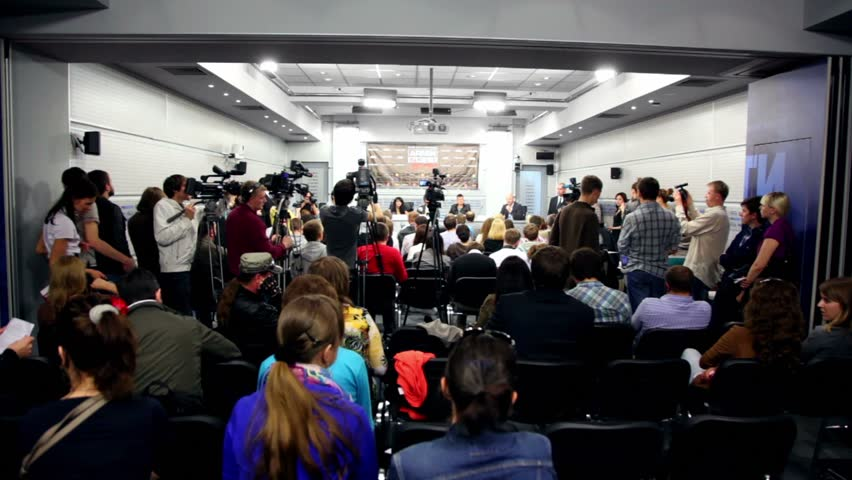 MOSCOW - MAY 6: Popular dutch DJ Armin Van Buuren speaks to journalists at press conferences in RIA Novosti hall, view from behind of operators, on May 6, 2011 in Moscow, Russia.