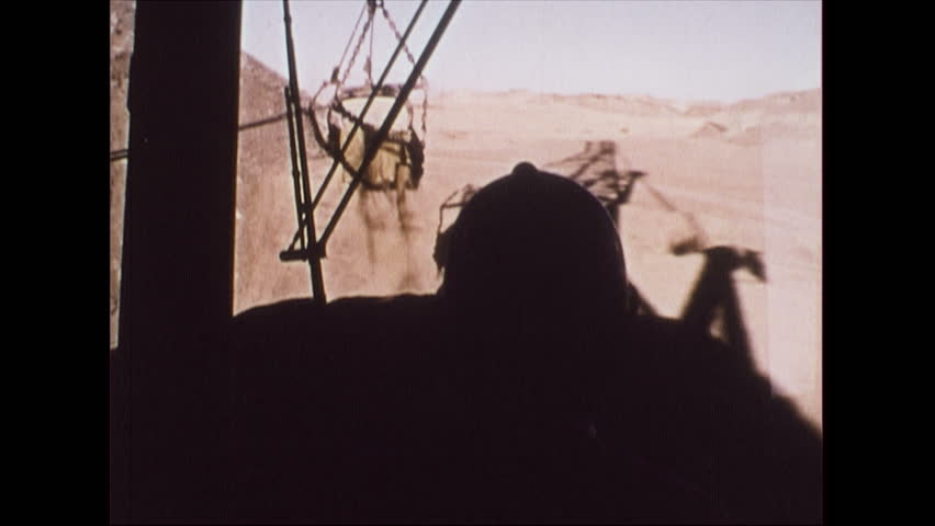 United States, 1975: View of oil mines and machinery. | Shutterstock HD Video #18027841