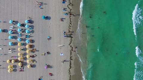 AERIAL - Beautiful view from the sky on the beach with tourists.