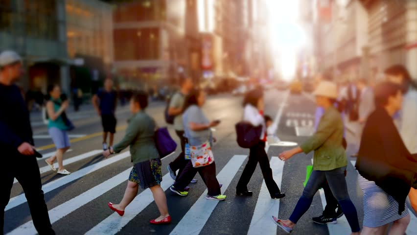 people walking in the city on crowded street. urban scenery of unrecognizable persons commuting to work in business district. new york metropolis scene background