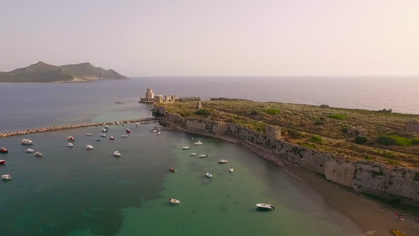 Aerial view from Methoni's Castle in Peloponnese, Greece. The fortress is located by the wonderful sea with rich coloured water. Low angle with forward motion.