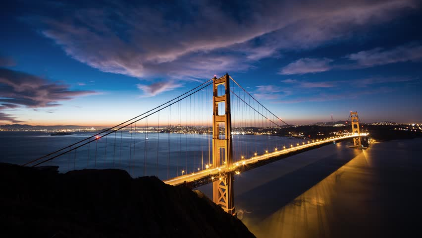 Dramatic sunrise over the red Golden Gate in San Francisco with blue and golden hour.