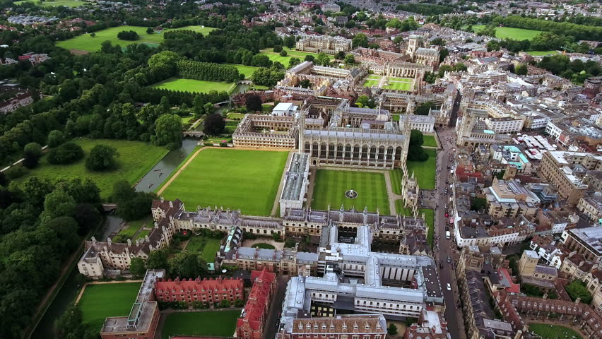 4K Aerial stock footage orbiting University of Cambridge with sunshine during summer; England, United Kingdom