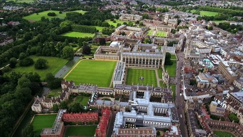 4K Aerial stock footage orbiting University of Cambridge with sunshine during summer; England, United Kingdom