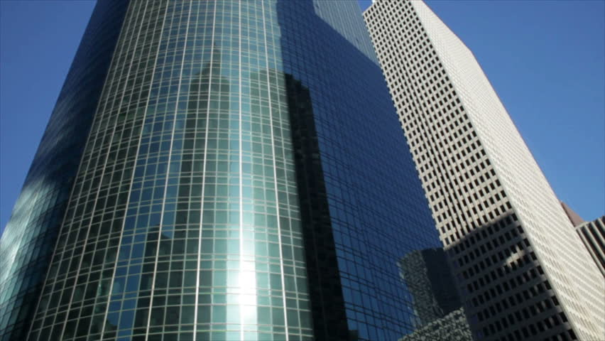 Driving past the tall and sometimes reflective exteriors of the professional office buildings in downtown Houston Texas.