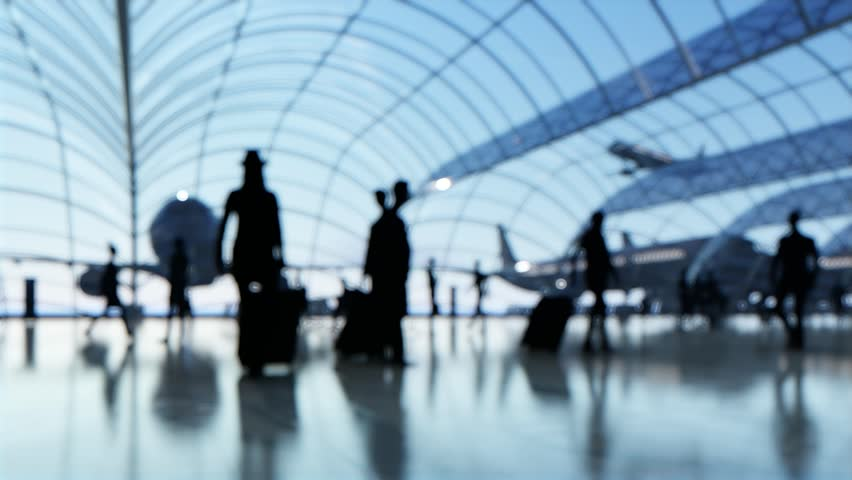 Silhouette blurred people walk in a passenger terminal Curved glass | Shutterstock HD Video #18218719