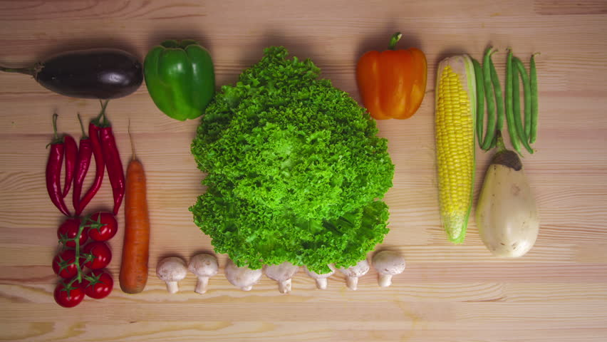 Kitchen Table Background moving vegetables on kitchen table, harvest background - stop