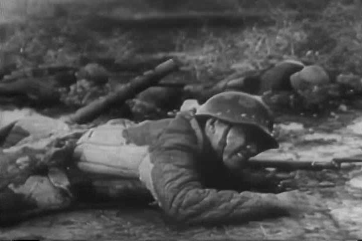 Nazis battle the Red Army in Stalingrad and in Leningrad, German officers surrender and the bodies of victims are shown, during World War 2. (1940s)
