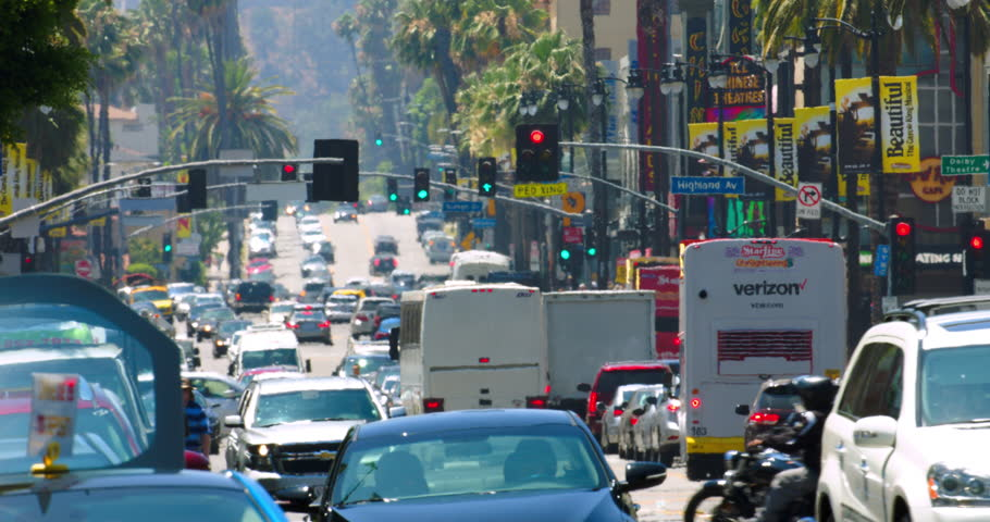 LOS ANGELES, CALIFORNIA, USA - JULY 3, 2016: Traffic jam on Hollywood Boulevard during the heat wave, heat distortion on background on July 3, 2016 in Los Angeles, California, 4K, from RAW